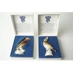 2 beeldjes van vogels in doosje met certificaat