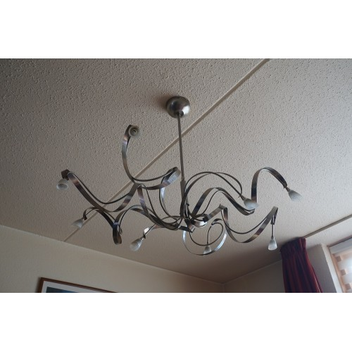 8 halogeen plafondlamp erg modern er zitten geen lampjes bij