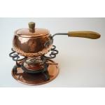 Stockli fondue stel van zwaar koper, mooi ter decoratie